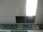 Two ceiling tiles down & 1 about to go