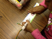 Student bookmarks had yarn attached to the end in honor of the book.