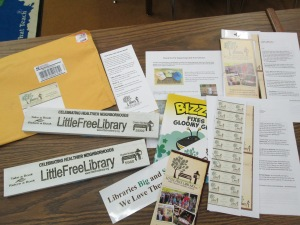 Labels, bumper stickers, ideas, and more were in our package from Little Free Libraries.