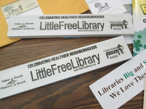 Our official signs will be mounted on our libraries once they are painted.