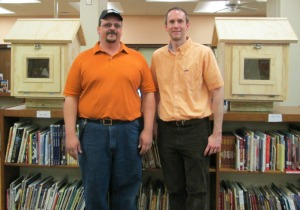 Kenny Sims, Operations Manager with Athens Home Depot, donates the 2 Little Free Libraries to Barrow