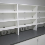 Equipment room charging shelves