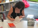 Gennifer spent time personalizing each book that students purchased