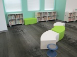 A wave of seating faces one instructional area and the nonfiction section