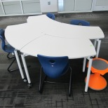 Table configuration with choices for seating: chairs or Hokki stools
